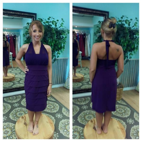 A stunning halter style bridesmaid dress featured in a gorgeous purple.
