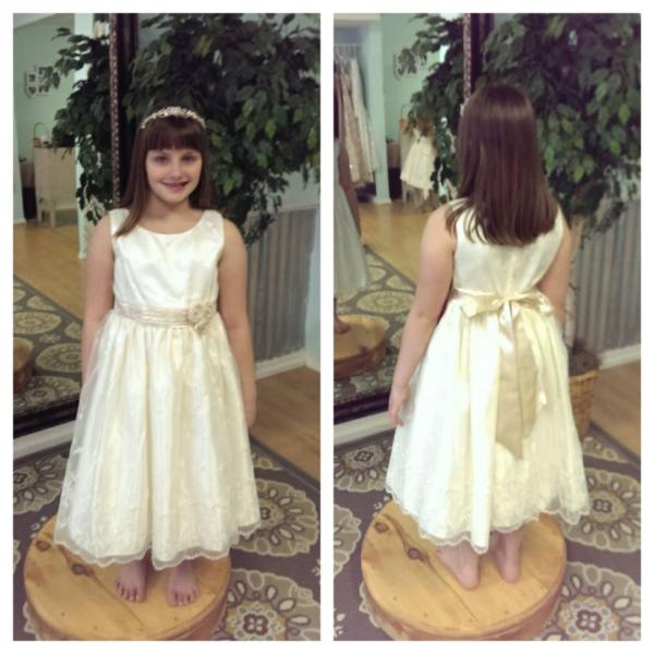 [Image: An adorable flower girl dress with a bow.]