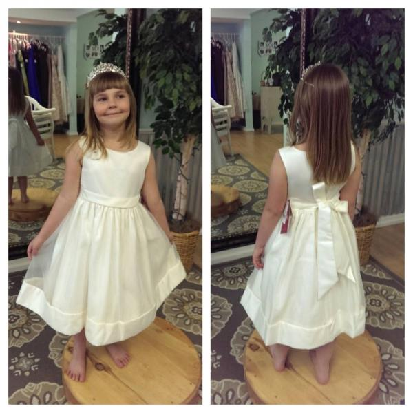 A beautiful sleeveless flower girl dress with bow.