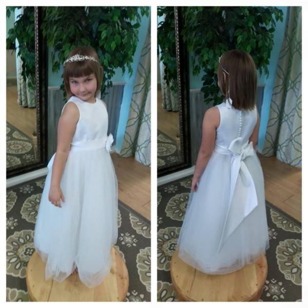 [Image: This adorable flower girl dress features a button back and bow in back.]