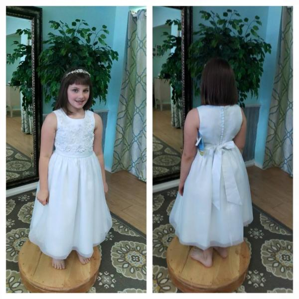 Lovie's Recycled Weddings offers affordable options for flower girl dresses. This dress has flower details on the front with a button up back. (Size 10)
