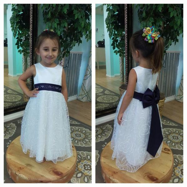 Find your little lady's flower girl dress at Lovie's Recycled Weddings. This adorable dress is complete with rose tulle and royal blue bow to match the bridesmaid's dress. (Size 2t)